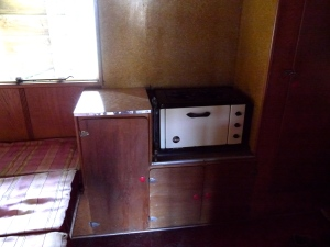 Original gas cooktop and oven -even has a wetback! Not sure if it still goes...